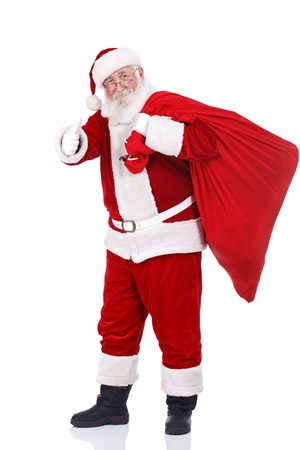 thumbs up: real Santa Claus carrying big bag and showing ok, isolated on white background