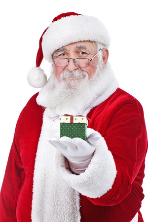 Santa Claus holding and offering a gift on his hand, isolated on white background photo