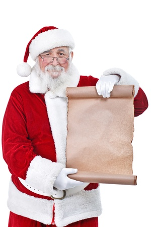 Traditional Santa Claus with a paper scroll, isolated on white background photo