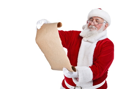 christmas list: Santa Claus reading gift list, isolated on white background Stock Photo