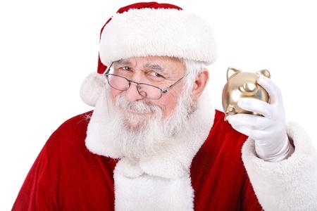 christmas budget: authentic Santa Claus holding gold piggy bank, Christmas budget Stock Photo