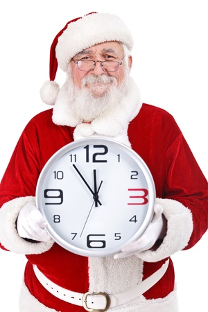 Santa Claus with real beard holding clock, clock showing five minutes to midnight, isolated on white background photo