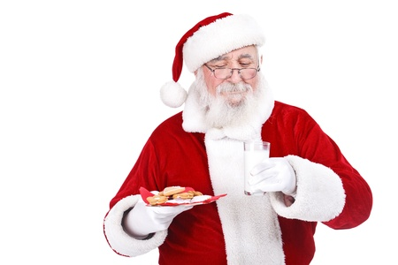 Traditional Santa with Christmas gingerbread cookies and a glass of milk, isolated on white background photo