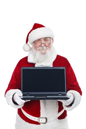 Santa Claus with laptop � copy space photo