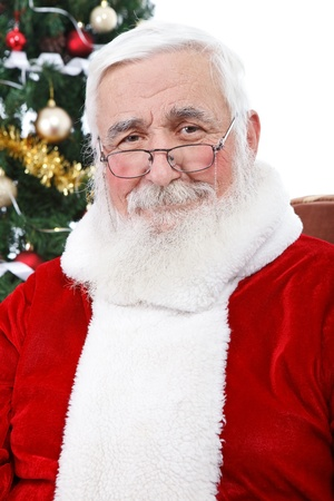 portrait of real Santa Claus with gray hair without hat, isolated on white background photo