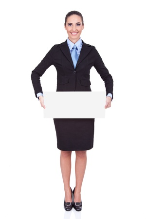 smiling young businesswoman holding blank banner, isolated on white background photo