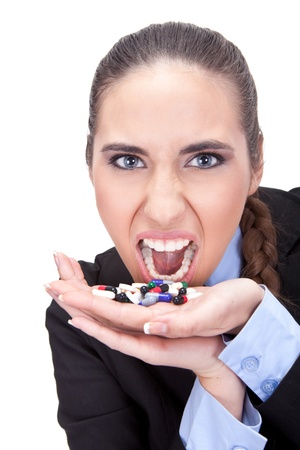 half open:  stressed and upset  businesswoman holding pills in her hand , isolated on white background Stock Photo