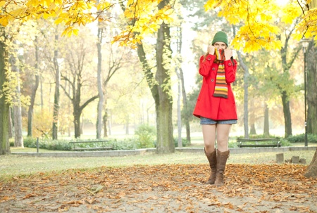 young attractive girl posing in cold autumn park photo