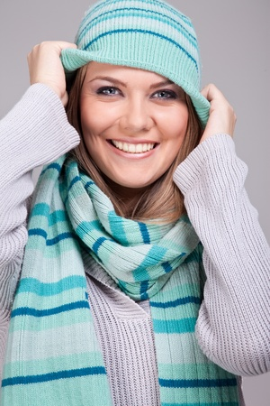 Portrait of a beautiful,  funny girl in warm clothing photo