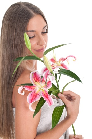 Beautiful woman with pink lily,  isolated on white background Stock Photo - 11735805