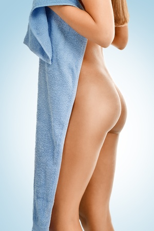 nude female buttocks: naked woman with perfect buttocks and towel,  on blue background
