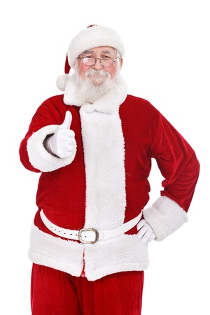 father Christmas or Santa Claus giving thumb up, isolated on white background photo