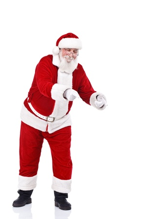 Santa Claus pointing with both hands in copy space, isolated on white background photo