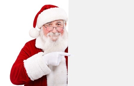Father Christmas pointing at banner on off white background photo