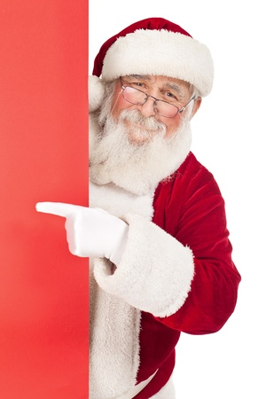 smiling Santa Claus pointing in red blank sing , isolated on white background photo