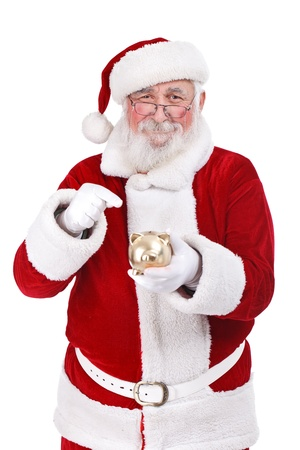 christmas budget: happy Santa Claus pointing gold piggy bank, isolated on white background Stock Photo