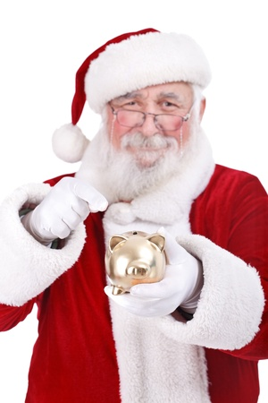 christmas budget: authentic Santa Claus pointing gold piggy bank, Christmas saving,  isolated on white background