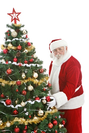 st nick:  Santa Claus decorating  Christmas tree,  last preparations for Christmas
