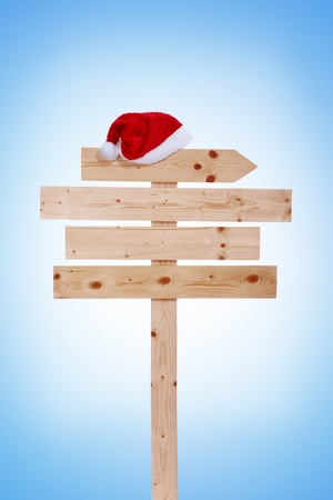 wooden board with Santa hat,  Christmas sign,  isolated on white background photo