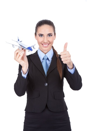 businesswoman employed in the airline agency with plan showing thumb up photo