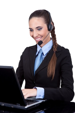 beautiful businesswoman or phone operator working on laptop , isolated on  white background photo