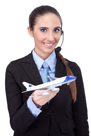 cheerful stewardess holding plane in her hand, information about flying photo