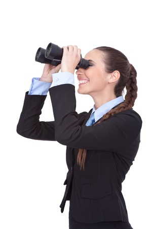 young businesswoman looking through binoculars,  isolated over white background photo