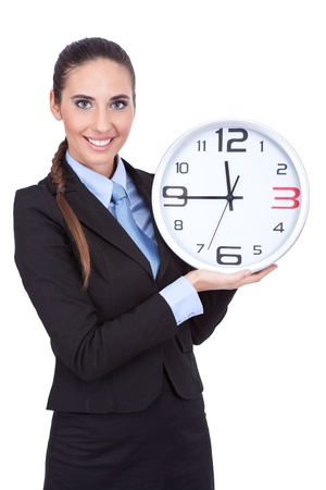 save time: smiling businesswoman holding clock and shoving time