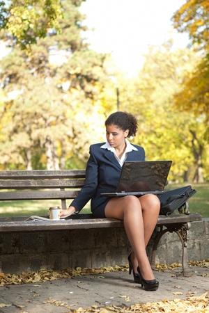 overworked businesswoman working on coffee break Stock Photo - 11859988