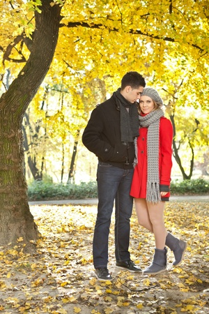 young love couple walking in autumn park, enjoying together   photo