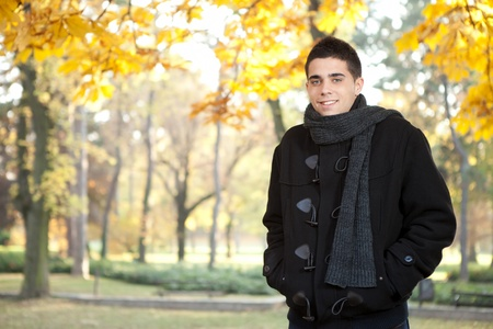 Freezing man standing in autumn park photo