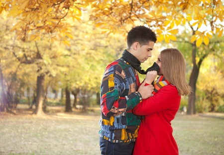 young couple looking at each other and having fun in autumn park  photo