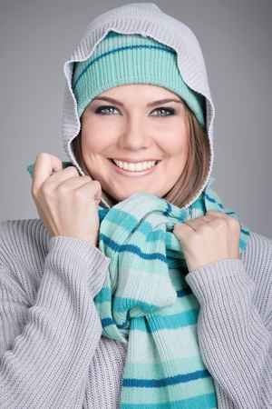 winter fashion portrait of young woman in warm clothes photo