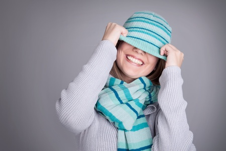 beanie: Laughing playful woman Stock Photo