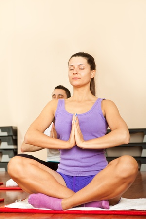 relaxed female concentrate on yoga exercise photo