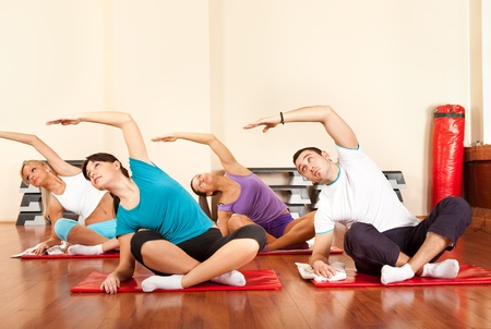Group of people in a stretching class at the gym photo