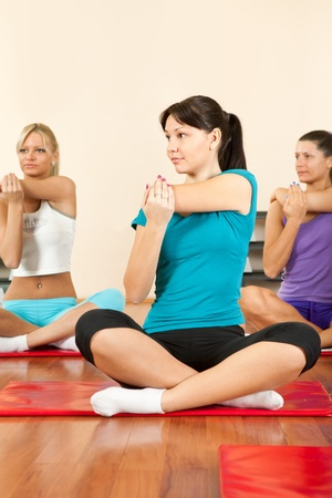 young beautiful women at the gym in a stretching class    Stock Photo - 12283433