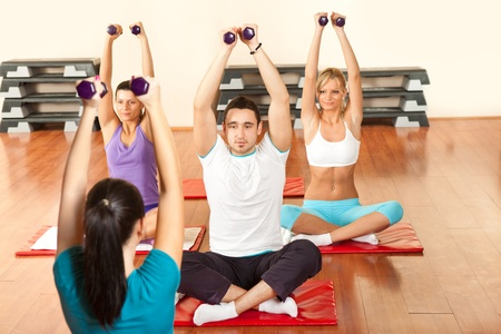 young people exercising with a personal trainer photo