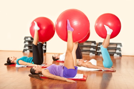 fitness group exercising with fitness ball photo