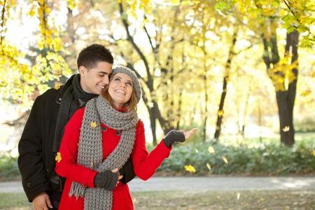 heterosexual couple: Portrait of couple enjoying golden autumn fall season Stock Photo