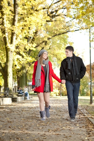 countryside loving:  couple in love walking in autumn park Stock Photo