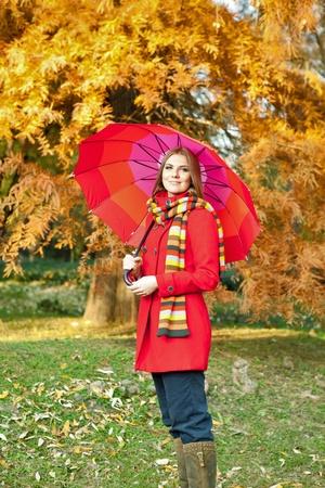 beautiful girl under red umbrella photo