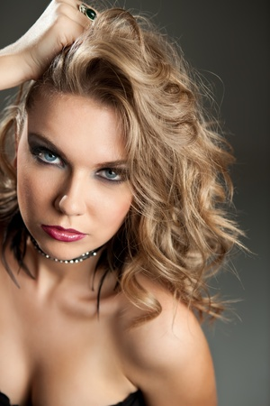 glamour portrait of beautiful curly blonde girl with stylish make-up photo