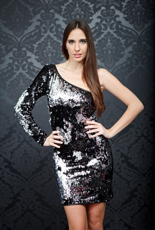 sequin:  Elegant fashion woman with night sequins dress dancing,  wallpaper background