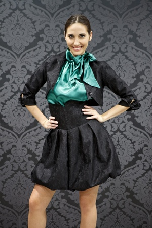young smiling woman  wearing chic clothing photo