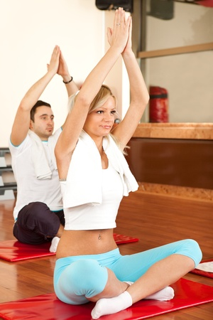 pilates man:  young woman sitting on mat and relaxing , yoga exercise Stock Photo