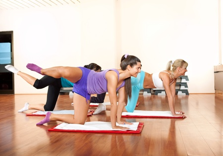 tracksuit: group of young women in fitness club doing exercise