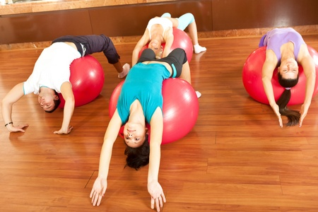 Women stretching with fitness balls photo