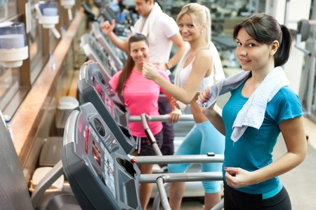 young women on treadmill at gym Stock Photo - 12283340