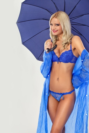 sexy woman with umbrella as sexy weather forecast Stock Photo - 12283273